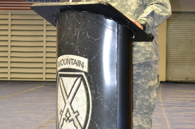 Col. Mark J. O'Neil, 10th Mountain Division (LI) deputy commander for operations, addresses the audience during a Mountain Salute ceremony Thursday on post.