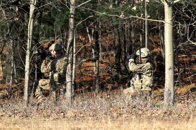 Two Soldiers from 2nd Brigade Combat Team conduct reconnaissance on what the Security Force Advise and Assist Team had identified as an improvised explosive device during the Best SFAAT Competition on Dec. 11 on Fort Drum. Each SFAAT must complete five major events within the allotted time before continuing to the next stage of the competition.