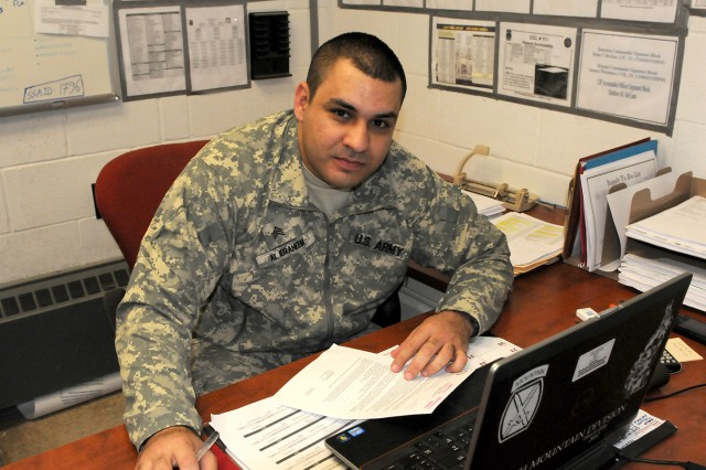 Sgt. Mustafa Al-Ibraheem, a member of D Company, 2nd Battalion, 87th Infantry Regiment, processes supply requests for his unit.
