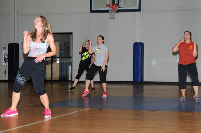 A Zumba class instructed by Danielle Dermer, Zumba instructor, does a choreographed number during a session at Fortenberry-Colton Physical Fitness Facility Dec. 18. Zumba is a low-impact, high-intensity workout that works the cardiovascular system and strengthens muscles and improves endurance.