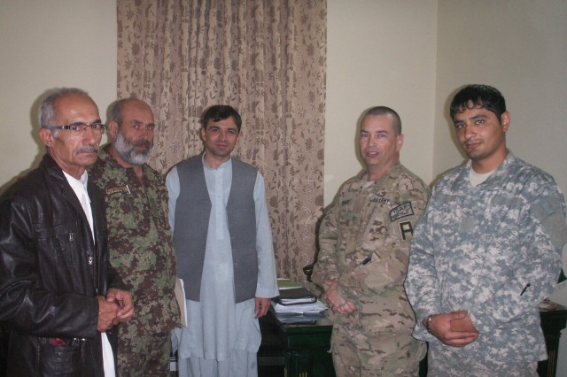 Afghan Army Col. Mohammad, Afghan Lt. Col. Baqi, Deputy Governor Patyal, Maj. Jerry Krieger, First Army Division East, Security Force Assistance Advisor Team, and Samim pose for a photo.
