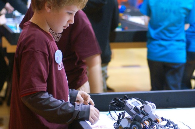 A robotics team member tests the autonomous LEGO MINDSTORM robot the team programmed at the Tulsa FIRST LEGO League qualifying event Nov. 10. About 300 children ages 6 - 14 participated in the event at Memorial High School in Tulsa using robots designed to perform specific functions.