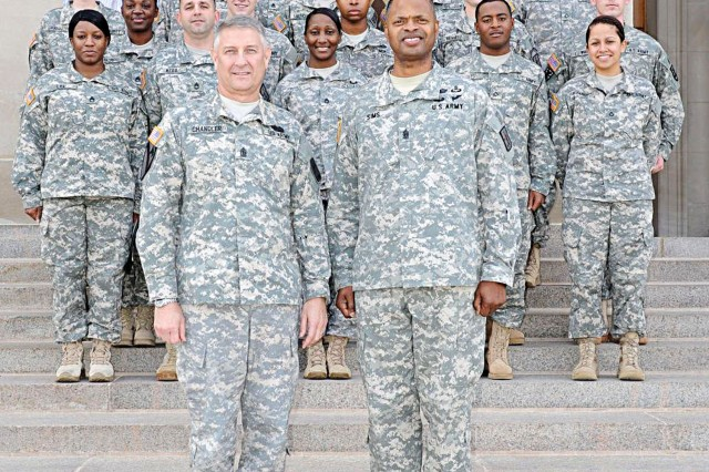 Sergeant Major of the Army Raymond F. Chandler III poses for a photo with Command Sgt. Maj. James K. Sims, CASCOM and Fort Lee CSM, and the 18 Soldiers and civilians who were recognized for their work on the Best Warrior Competition during a Dec. 12 ceremony at the Pentagon.