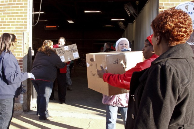 Anniston Army Depot employees load boxes of presents to a truck that will take the gifts to the Calhoun County Department of Human Resources Dec. 19. The gifts are part of the depot's Christmas Cheer program, which gives presents valued between $150 and $175 to children in protective custody at DHR. The children are anonymous, known to the givers only by a first name, a number and their age.