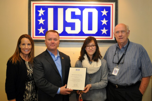 To support those who serve far away from home during the holiday season, members of Seoul American Middle School's National Junior Honor Society donated $2,000 worth of phone cards to the local USO, Dec. 18, 2012.