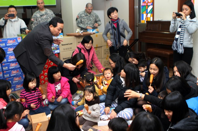 Army brings toys, food to local orphans