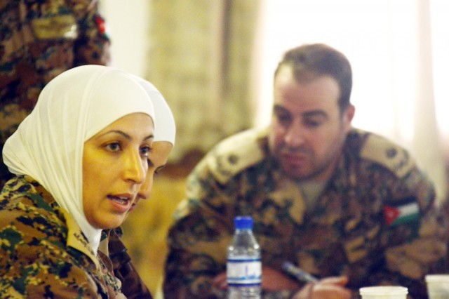 Jordanian army 2nd Lt. Hotaf Almahasnah, a security integration officer deployed to Afghanistan, provides her perspective during a coalition forces-led Female Engagement Team conference at Bagram Air Field, Afghanistan, Dec. 18, 2012. (U.S. Army photo by Staff Sgt. David J. Overson, 115th Mobile Public Affairs Detachment)