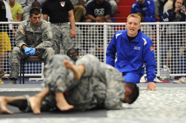 "Staff Sgt. Colton Smith coaches during the 2012 U.S. Army Combatives Championship, July 28, 2012, at Fort Hood, Texas. Filming for season 16 of ""The Ultimate Fighter"" began in Las Vegas days after the tournament. Smith won the season 16 title in a nationally televised unanimous decision, Dec. 15, 2012."