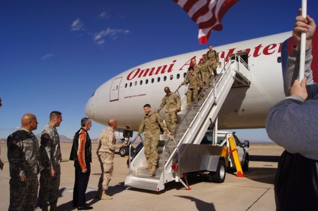 Col. Patrick Dedham, commander, 11th Theater Tactical Signal Brigade, and the rest of his command team smile as they step off the plane bringing him and the rest of the Thunderbird family back to Fort Huachuca. Approximately 60 Soldiers from Headquarters and Headquarters Company, 11th TTSB arrived at Libby Airfield Dec. 13 following an 11-month deployment in Afghanistan.