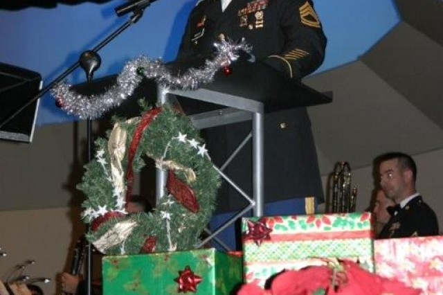 "Sgt. 1st Class Craig Hannum, 18th Military Police Detachment sergeant, was the master of ceremonies during the ""Sounds of the Season concert presented by the United States Military Intelligence Corps Band."""