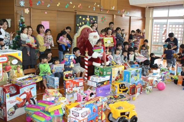 Members of the U.S. Army Garrison Torii Station purchased toys for children at a local special needs school while Sgt. Jonathan Pitts portrayed jolly old St. Nick.