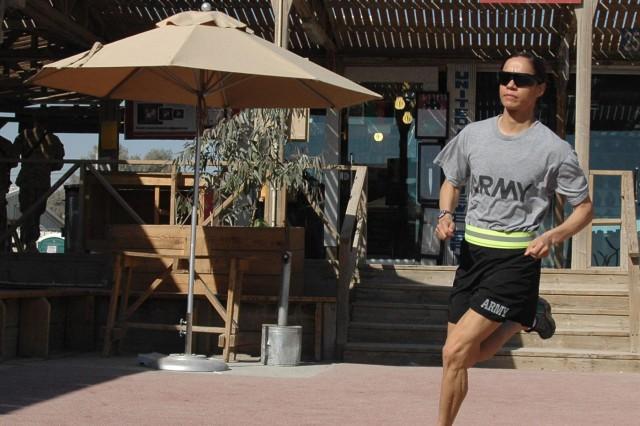 Former National Guard Bureau marathon champion Capt. Varinka Barbini Ensminger works out on the boardwalk running track at Kandahar Airfield, Afghanistan. Ensminger's deployment with the Kandahar Agri-business Development Team concluded in late December.