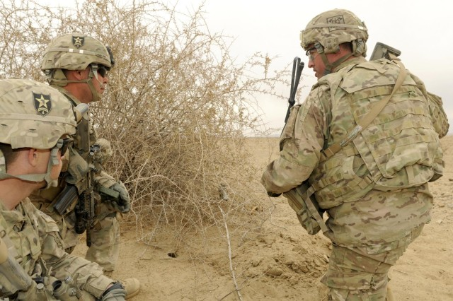 Sgt. 1st Class James Henderson, a platoon sergeant, talks about claymores to Spc. Johnathon Hails, a vehicle commander and Pfc. Jeremiah Carter, a rifleman, during Operation Southern Fist II, Afghanistan, Dec. 12. The purpose of the four-day operation was to neutralize enemy safe havens in Shorabak district, which is located in a remote area 55 miles south of Spin Boldak district near the Pakistan border. All three Soldiers are with Company Bravo, 2nd Battalion, 23rd Infantry Regiment.