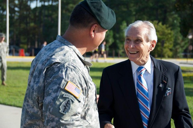 Maj. Gen. Edward M. Reeder Jr., commanding general of the U.S. Army John F. Kennedy Special Warfare Center and School, stands beside retired Col. Walter F. Goodman, a World War II veteran, after officially recognizing him as a distinguished member of the Army's Civil Affairs regiment during the Civil Affairs Qualification Course Regimental Induction Ceremony Sept. 21 on Fort Bragg, N.C. (U.S. Army photo by Dave Chace, SWCS Public Affairs Office)