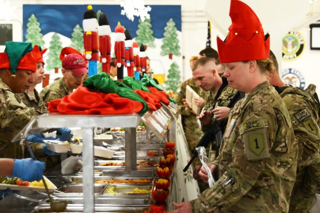 Soldiers deployed to Afghanistan in support of Operation Enduring Freedom are served Christmas dinner from their command group at Bagram Airfield, Dec. 25, 2012. (U.S. Army photo by Staff Sgt. David J. Overson, 115th Mobile Public Affairs Detachment)