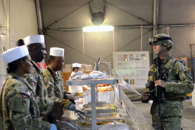 A Soldier deployed to Afghanistan in support of Operation Enduring Freedom is served Christmas dinner from his command group at Bagram Airfield, Dec. 25, 2012. (U.S. Army photo by Staff Sgt. David J. Overson, 115th Mobile Public Affairs Detachment)