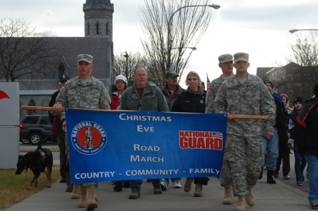 New York Army National Guard Soldiers, families, friends and supporters from the community march in the the 9th annual Christmas Eve road march in Glens Falls, N.Y.  The march is a tribute to all military personnel serving away from home for the holidays this year.