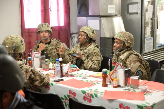 Junior Soldiers from different units enjoy a meal together at the Kolle dining facility on Bagram Airfield, Afghanistan on Christmas day. (U.S. Army photo by Sgt. Duncan Brennan, 101st CAB public affairs)