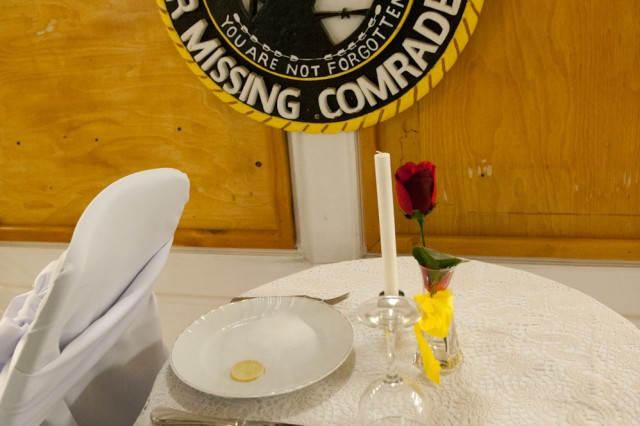 Members of the Armed Forces never leave. The table reserved for the prisoners of war and those missing in action is a reminder to us all that some gave all and all gave some. (U.S. Army photo by Sgt. Duncan Brennan, 101st CAB public affairs)