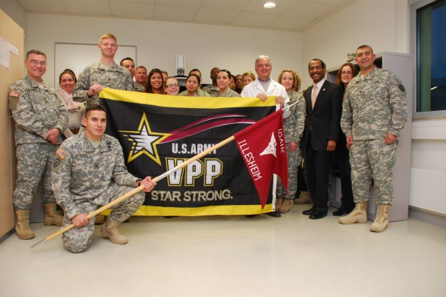 Staff at the Illesheim Health Clinic gather for a group photo at an Army Star Strong Flag Ceremony on Storck Barracks, Germany, Dec. 20, 2012. The clinic was the first U.S. Army Medical Command unit to achieve the Voluntary Protection Program Star Status.