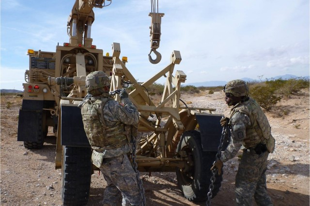 The Contact Response Team from the 321st Engineer Company recovers a disabled Husky vehicle Dec. 16.