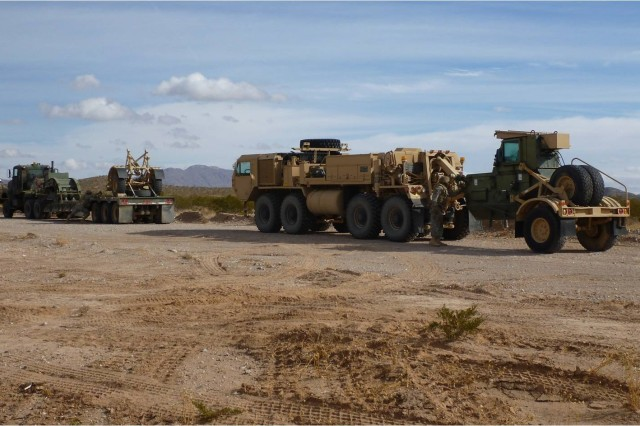 The 321st Engineer Company's Contact Response Team departs for base upon successful completion of a recovery operation during the unit's culminating training exercise Dec. 16.