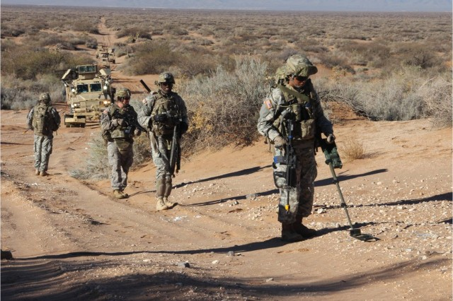 Engineers with the 321st Engineer Company conduct a dismounted sweep Dec. 16.