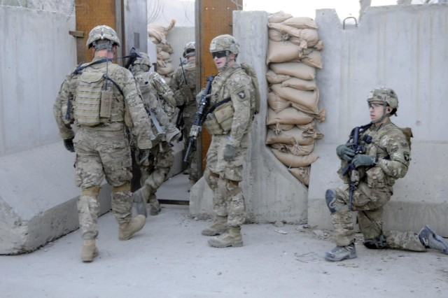 Soldiers from 3rd Platoon, Company D, 1st Battalion, 327th Infantry Regiment, 1st Brigade Combat Team, 101st Airborne Division (Air Assault), move into the Afghan Customs Department at Torkham Gate, Afghanistan, Dec. 20, 2012.  The gate lies on the border of Afghanistan and Pakistan and is monitored by the Afghan Customs Police, Afghan Border Police and the National Directorate of Security.
