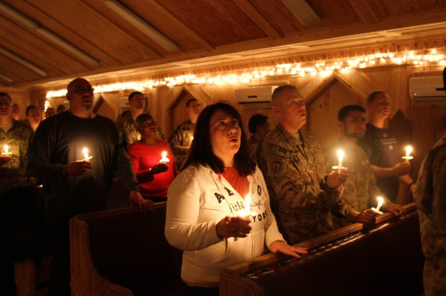 KHOWST PROVINCE, Afghanistan - Soldiers and civilians participate in a candlelight service at Chapel Next on Forward Operating Base Salerno, Afghanistan, Dec. 24, 2012. Soldiers and civilians participated in the traditional Christmas service, celebrating the holiday season despite being deployed and away from their families.  (U.S. Army photo by Spc. Brian Smith, TF 3/101 Public Affairs