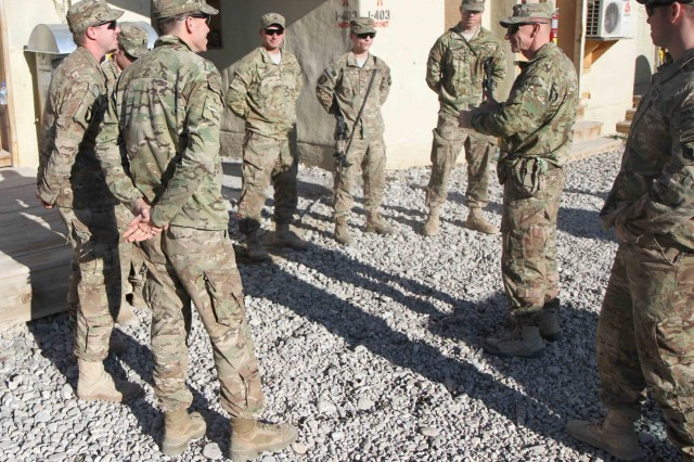 "PAKTYA PROVINCE, Afghanistan "" Command Sgt. Maj. Eric Crabtree, Command Sgt. Maj., 3rd Brigade Combat Team ""Rakkasans,"" 101st Airborne Division (Air Assault), visits Soldiers of Headquarters Company, 1st Battalion, 187th Infantry Regiment, at Forward Operating Base Gardez to personally wish his Soldiers a merry Christmas, Dec. 25, 2012. Command Sgt. Maj. Crabtree, along with the Commander of the 3rd BCT, Col. R.J. Lillibridge, visited four different Combat Outposts and FOBs during Christmas in hopes to help boost morale during their combat tour in support of Operation Enduring Freedom. (U.S. Army photo by Sgt. 1st Class Abram Pinnington, TF 3/101 Public Affairs)"