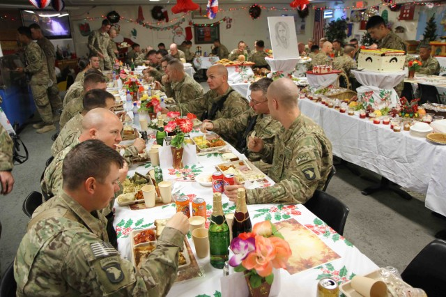 "KHOWST PROVINCE, Afghanistan "" Soldiers enjoy their Christmas-day lunch at the Camp Clark, Afghanistan dining facility, Dec. 25, 2012. The facility staff began preparing for the holiday meal 4 days in advance. They offered more than 30 different types of deserts, 10 different meals, and numerous of other selections of drinks, fruits and salads. (U.S. Army photo by Sgt. 1st Class Abram Pinnington, TF 3/101 Public Affairs)"