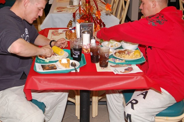The Soldier Fueling Initiative aims to offer healthier food choices at all Army dining facilities but it will still be up to the Soldier to make the right choices. Here, Pvt. Cody Maynard (left) and Pvt. Shawn Thompson enjoy a mostly healthy Thanksgiving meal at the Stafford Dining Facility at Fort Bliss, Texas.