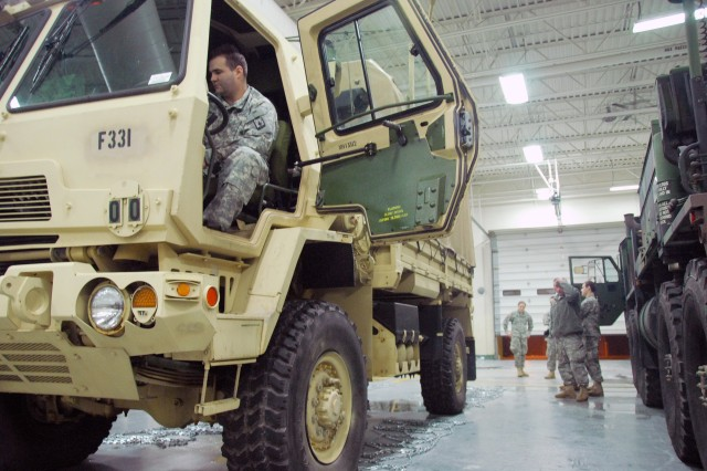 A Wisconsin National Guard member at the Sussex armory readies a light medium tactical vehicle for use during a major snowstorm that hit Wisconsin, Dec. 19, 2012.
