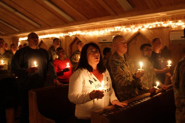 Soldiers and civilians participate in a candlelight service at Chapel Next on Forward Operating Base Salerno, Afghanistan, Dec. 24, 2012. Soldiers and civilians participated in the traditional Christmas service, celebrating the holiday season despite being deployed and away from their families.