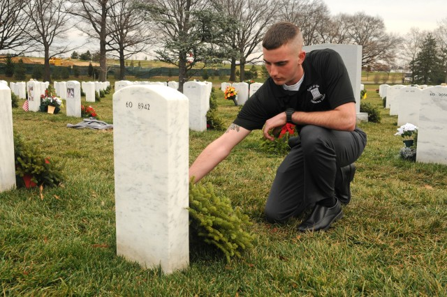 Pfc. Jacob Davenport, an infantryman with Headquarters and Headquarters Company, 3d U.S. Infantry Regiment (The Old Guard), visits the gravesite of his great-uncle, retired Col. Talmadge N. Gilley Jr., Dec. 17, 2012, in Arlington National Cemetery, Va. Gilley served as a Tomb Sentinel from July 1957 until August 1958. Davenport, who is currently in training to become a Tomb guard, hopes to follow in his great-uncle's footsteps.