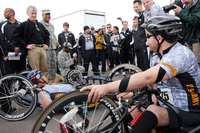 The 2013 Warrior Games are slated for May 11-17, Colorado Springs, Colo. More than 200 wounded, ill and injured service members and veterans are expected to participate in 2013 games. Pictured here, Army Secretary John M. McHugh speaks with Army cycling team members Tim Patterson and Juan Soto before the beginning of the 2012 Warrior Games in Colorado Springs, Colo., May 1, 2012.