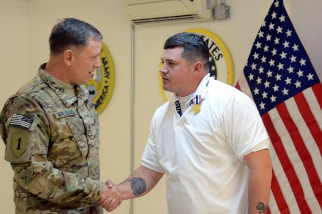 Injured contractor receives medal