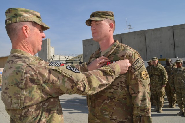 Colonel Mark A. Paget, 401st Army Field Support Brigade commander, awards a Bronze Star Medal to Lt. Col. Stephen, M. Bousquet, 4th Brigade Support Battalion, 27th Brigade Combat Team commander and 401st AFSB deputy support operations officer Dec. 22 in recognition of his achievements during his deployment from Apr. 15 to Dec. 30, 2012. The 4/27 is a New York Army National Guard unit.