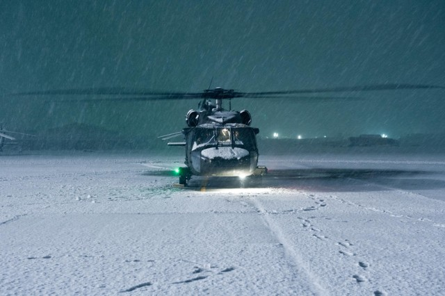 A UH-60 Black Hawk helicopter with A Company, 5th Battalion, 101st Combat Aviation Brigade, gets run-up to ensure mission readiness during a snow storm on Bagram Air Field, Afghanistan, Dec. 27, 2012. (U.S. Army photo by Sgt. Duncan Brennan, 101st CAB public affairs)