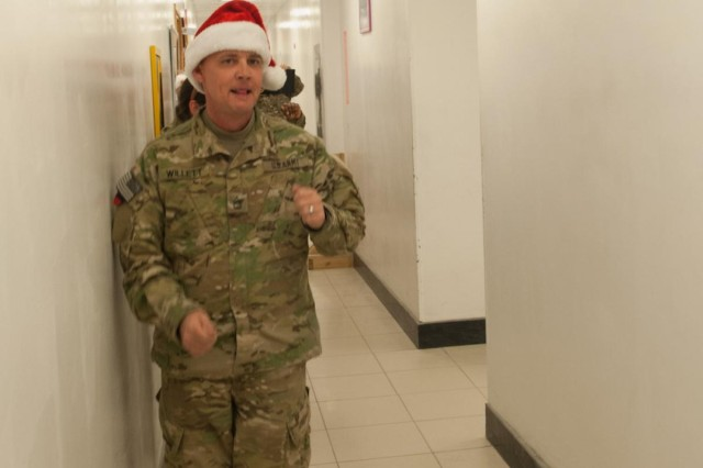 Sgt. 1st Class Jesse Willett, Headquarters and Headquarters Company, 101st Combat Aviation Brigade air space command and control noncommissioned-officer-in-charge, dances in the hallway of the 101st CAB headquarters building on Bagram Air Field, Afghanistan during a Christmas-themed flash mob on Christmas morning. Willett's daughter, Emily Jean, taught him the dance prior to his deployment. (U.S. Army photo by Sgt. Duncan Brennan, 101st CAB public affairs)
