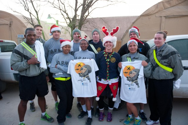 Soldiers from Headquarters and Headquarters Company, 101st Combat Aviation Brigade pose for a picture after the 'Jingle Bell 5k' run at Bagram Air Field, Afghanistan Christmas morning. (U.S. Army photo by Sgt. Duncan Brennan, 101st CAB public affairs)