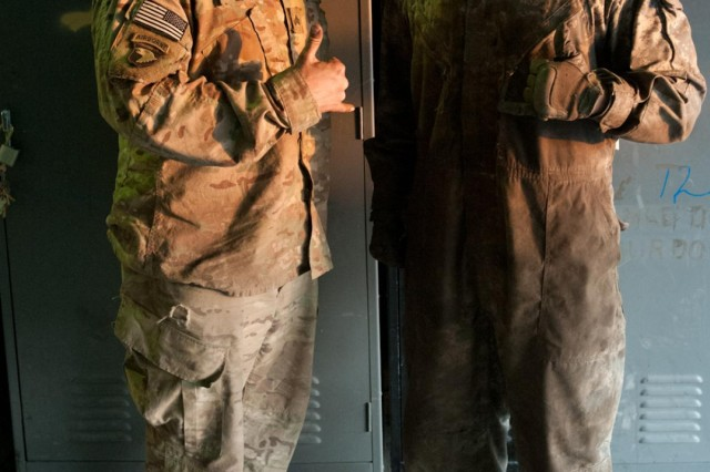 Spc. Joshua Finley, allied trade specialist, a native of Cortez, Colo., and Sgt. Joseph Lowery, machinist noncommissioned officer, a native of Leitchfield, Ky., both with E Troop, 2nd Squadron, 17th Cavalry Regiment pause during the construction of the replacement gate to take a photo Dec. 11. (U.S. Army photo by Sgt. Duncan Brennan, 101st CAB public affairs)
