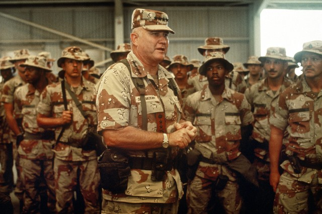 U.S. Army Gen. Norman H. Schwarzkopf, commander of U.S. Central Command, speaks to U.S. soldiers inside a hangar while visiting a base camp during Operation Desert Shield, April 1, 1992.