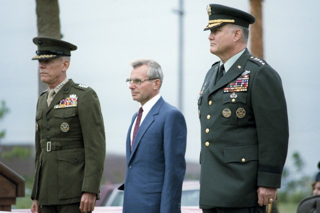Defense Secretary Frank C. Carlucci, center, transfers the reins of command of U.S. Central Command from U.S. Marine Corps Gen. George B. Crist, left, to Army Gen. H. Norman Schwarzkopf, Nov. 1, 1988. Schwarzkopf was a Vietnam veteran and one of the architects of the western flanking movement that helped to defeat the Iraqi army during the Gulf War in early 1991. As commander of U.S. Centcom, he led the international coalition assembled by then-President George H.W. Bush that expelled Iraqi troops who had invaded Kuwait in August 1990.