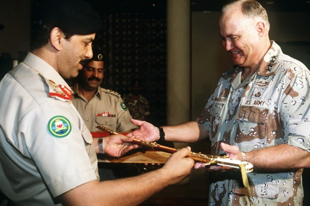During a ceremony at defense forces headquarters, Maj. Gen. Shaikh Khalifa Bin Ahmed Al-Khalifa, minister of defense, presents Gen. Norman Schwarzkopf, commander of U.S. Central Command, with a sword in recognition of his role in the Allied success during Operation Desert Storm, March 26, 1991.