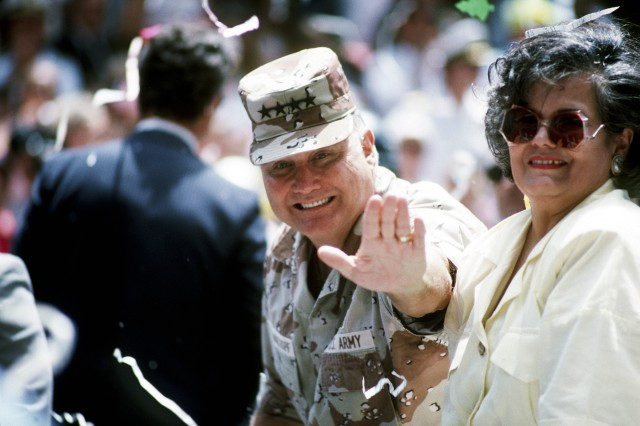 Army Gen. H. Norman Schwarzkopf, commander of U.S. Central Command, accompanied by his wife, Brenda, waves to the cheering crowd during the welcome home parade honoring the men and women who served in Desert Storm, June 10, 1991.
