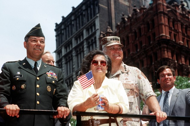 Army Gen. Colin Powell, chairman of the Joint Chiefs of Staff, left, Army Gen. H. Norman Schwarzkopf, commander of U.S. Central Command, and his wife, Brenda, ride in the welcome home parade, June 10, 1991, to honor the men and women who served in Desert Storm.