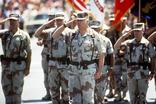 Army Gen. H. Norman Schwarzkopf, center, salutes as he arrives in front of the reviewing stand at the head of the National Victory Celebration parade. The day-long celebration, June 8, 1991, was being held in honor of the coalition forces that liberated Kuwait during Operation Desert Storm.