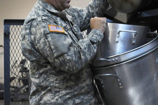 Spc. Steven L. Platt of Joplin, Mo., with the 329th Combat Support Sustainment Battalion, a Reserve unit, inventories kitchen equipment at the Nevada National Guard Armory in Winnemucca, Nev., on July 8.