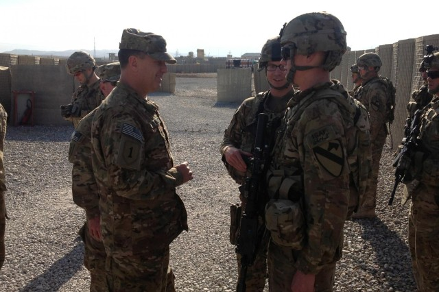 U.S. Army Pfc. Michael Bardford (right), a combat engineer for C Company, 4th Brigade Special Troops Battalion, 4th Brigade Combat Team, 1st Cavalry Division, gets recognized by Maj. Gen. William Mayville (left), commanding general of CJTF-1 and RC-East, on Dec. 22, 2012. Also pictured is Bardford's platoon leader 1st Lt. Hudson Dunn (center) of Wolford, N.D. Bardford, a Yuba City, Ca. native, who is currently serving with the brigade in Laghman Province, Afghanistan.  (Courtesy Photo by U.S. Army 1st Lt. Hudson Dunn, C Co., 4th BSTB, 4th BCT, 1st Cav. Div.)